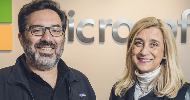 Susana Garcia Robles, chief investment officer of IDB Lab and Mariano Amartino from Microsoft Latin America infront of Microsoft backdrop logo